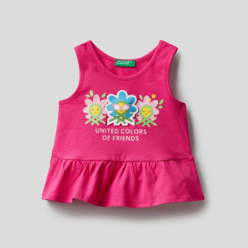 100% cotton tank top with frill on the bottom