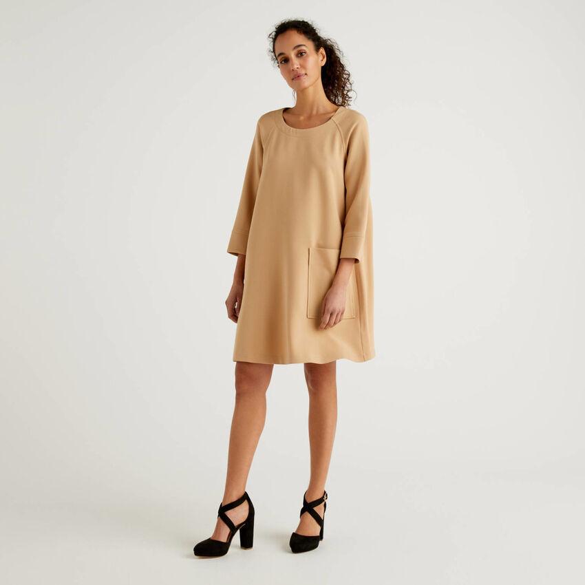 Flared dress with maxi pocket