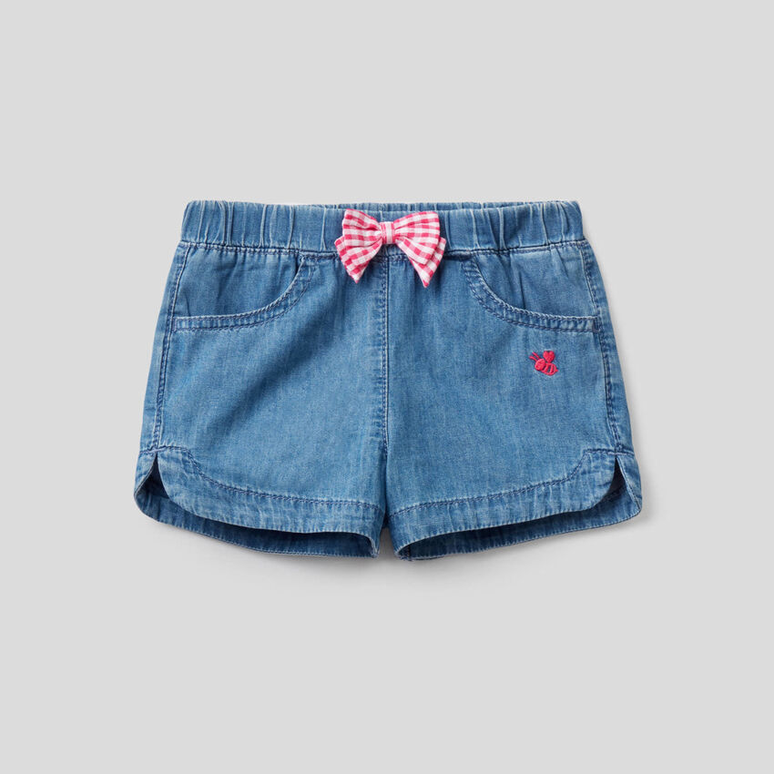 Shorts in light denim with bow