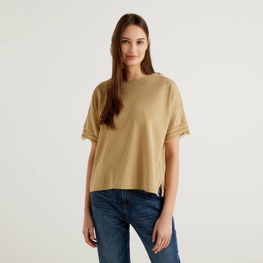 Sweater with frayed sleeves