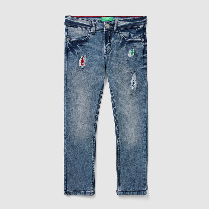 Slim fit jeans with colorful patches