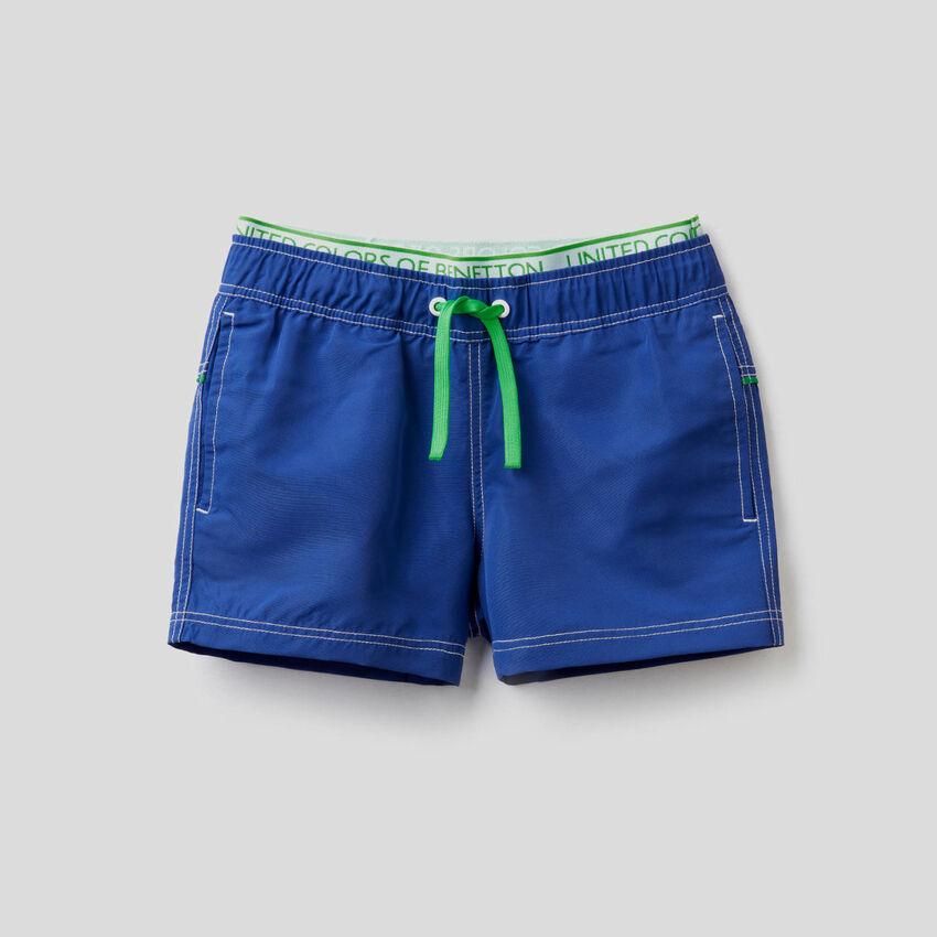 Swim trunks with neon details